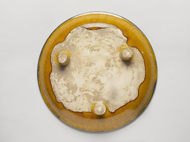 Tripod Plate, 618-907. Earthenware, 3 color (sancai) lead glaze, 2 3/8 x 11 3/4 in. (6 x 29.9 cm). Brooklyn Museum, William E. Hutchins Collection, 53.90. Creative Commons-BY