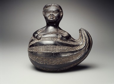 Chimú. Effigy Vessel in Form of a Human Figure Emerging from a Gourd, possibly 17th or 18th century. Ceramic, 8 1/2 x 8 1/2 x 6 in. (21.6 x 21.6 x 15.2 cm). Brooklyn Museum, Gift of Florence Walker, 53.97.1. Creative Commons-BY