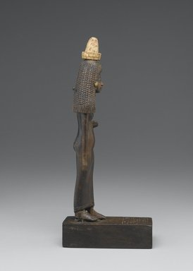 Standing Statuette of Lady Tuty, ca. 1390-1352 B.C.E. Wood, gold leaf, 10 1/4 x 1 7/8 x 5 1/2 in. (26 x 4.8 x 14 cm). Brooklyn Museum, Charles Edwin Wilbour Fund, 54.187. Creative Commons-BY