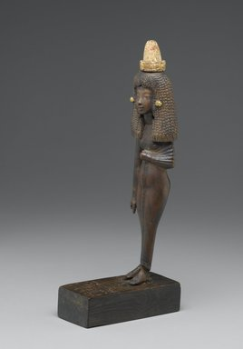 Standing Statuette of Lady Tuty, ca. 1390-1352 B.C.E. Wood, gilded, 10 1/4 x 1 7/8 x 5 1/2 in. (26 x 4.8 x 14 cm). Brooklyn Museum, Charles Edwin Wilbour Fund, 54.187. Creative Commons-BY