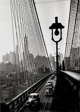 Esther Bubley (American, 1921-1998). New York Harbor, Looking Toward Manhattan from the Footpath on Brooklyn Bridge, October 1946, 1946. Silver gelatin photograph, sheet: 13 1/8 x 9 1/8 in. (33.3 x 23.2 cm). Brooklyn Museum, Gift of Standard Oil Company, New Jersey, 54.201.3. Standard Oil (New Jersey) Collection, Photographic Archives, University of Louisville