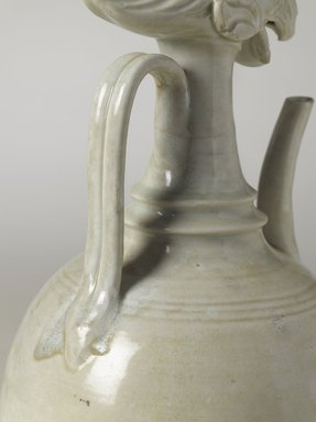 Ewer with Phoenix Head, ca. 10th century. Qingbai ware, stoneware, translucent glaze, height: 14 9/16 in. (37 cm); diameter: 6 7/8 in. (17.5 cm). Brooklyn Museum, Ella C. Woodward Memorial Fund and Frank L. Babbott Fund, 54.7. Creative Commons-BY