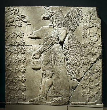 Assyrian. Relief of Eagle-Headed Winged Figure Standing Between Two Sacred Trees, ca. 883-859 B.C.E. Alabaster, 84 13/16 x 83 1/8 in. (215.5 x 211.2 cm). Brooklyn Museum, Purchased with funds given by Hagop Kevorkian and the Kevorkian Foundation, 55.156. Creative Commons-BY