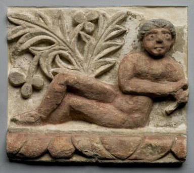 Frieze Fragment with Semi-Reclining Nude, 4th - 5th century C.E., with 20th century alterations. Limestone, painted, 11 x 12 5/8 x 4 in. (28 x 32 x 10.2 cm). Brooklyn Museum, Charles Edwin Wilbour Fund, 55.2.2. Creative Commons-BY