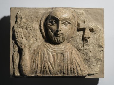 Coptic. Bust of a Saint, 4th - 5th century C.E. Limestone, traces of paint, 8 1/4 x 10 15/16 x 4 1/8 in. (21 x 27.8 x 10.5 cm). Brooklyn Museum, Charles Edwin Wilbour Fund, 55.2.3. Creative Commons-BY