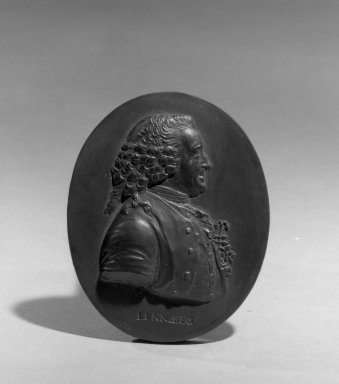 Wedgwood & Bentley (1759-present). Portrait Medallion, ca.1775. Basaltes, 3 1/8 x 2 1/8 in. (7.9 x 5.4 cm). Brooklyn Museum, Gift of Emily Winthrop Miles, 55.9.10. Creative Commons-BY