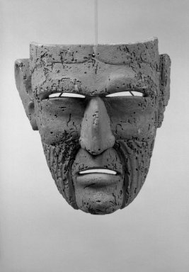 Carved Mask. Wood, 10 1/2 x 8 15/16 in.  (26.7 x 22.7 cm). Brooklyn Museum, Gift of Arturo and Paul Peralta-Ramos, 56.6.17. Creative Commons-BY