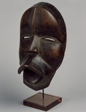 Dan. Mask, late 19th or early 20th century. Wood, leather (replacement hinges), applied material, 9 3/4 x 5 1/2 x 4 in. (24.8 x 14 x 10.2 cm). Brooklyn Museum, Gift of Arturo and Paul Peralta-Ramos, 56.6.25. Creative Commons-BY