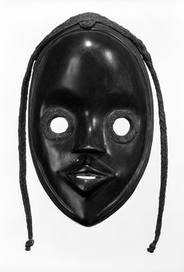 Dan. Mask, late 19th-early 20th century. Wood, fiber, resin, 10 1/4 x 5 5/8 in.  (26.0 x 14.3 cm). Brooklyn Museum, Gift of Arturo and Paul Peralta-Ramos, 56.6.26. Creative Commons-BY