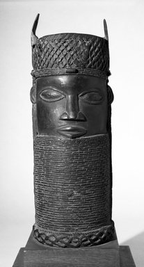 Edo. Benin Head, early 20th century. Copper alloy,, 14 9/16 x 4 7/8 in. (37 x 12.4 cm). Brooklyn Museum, Gift of Arturo and Paul Peralta-Ramos, 56.6.66. Creative Commons-BY