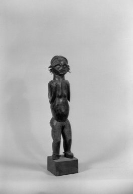 Ngbaka. Figure of Standing Female, late 19th-early 20th century. Wood, metal, plastic beads, 12 1/4 x 4 1/2 x 3 1/2 in. (54.0 x 11.7 x 8.2 cm). Brooklyn Museum, Gift of Arturo and Paul Peralta-Ramos, 56.6.85. Creative Commons-BY