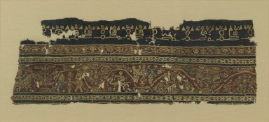 Textile Fragment with Figural and Floral Motifs and Inscriptions, 7th-8th century. Wool, linen, 8 7/8 x 26 7/8 in. (22.5 x 68.3 cm). Brooklyn Museum, Anonymous gift, 57.120.3. Creative Commons-BY