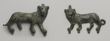 Lion Applique, 4th-3rd century B.C.E. Bronze, 5 5/8 x 8 1/8 in. (14.3 x 20.7 cm). Brooklyn Museum, Charles Edwin Wilbour Fund, 57.40. Creative Commons-BY