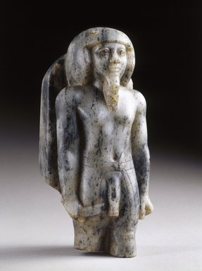 Statuette of a Male Deity, ca. 2675-2625 B.C.E. Gneiss, 8 3/8 x 3 5/8 in. (21.3 x 9.2 cm). Brooklyn Museum, Charles Edwin Wilbour Fund, 58.192. Creative Commons-BY