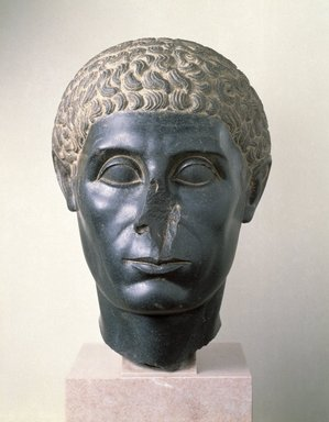 Head of an Egyptian Official, ca. 50 B.C.E. Diorite, 16 5/16 x 11 1/4 x 13 7/8 in. (41.4 x 28.5 x 35.2 cm). Brooklyn Museum, Charles Edwin Wilbour Fund, 58.30. Creative Commons-BY