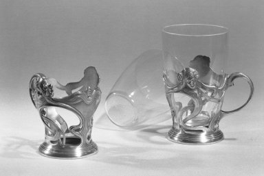 Wurttembergische Metallenwarenfabrik (1853-present). Glass Holder, ca. 1900. Silver, glass Brooklyn Museum, Gift of Jeanette Praeger, 59.203.1a-b. Creative Commons-BY