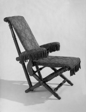 George Jacob Hunzinger (American, born Germany, 1835-1898). Reclining Armchair, patented February 6, 1866. Walnut, various woods, original fringe, late 19th century second show cover, original upholstery retained below on armrests Brooklyn Museum, Bequest of Elsie Patchen Halstead, 60.133.2. Creative Commons-BY