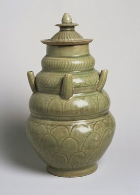 Covered Funeral Vase, 960-1127. High-fired green ware (celadon), 11 13/16 x 6 7/8 in. (30 x 17.4 cm). Brooklyn Museum, Gift from the collection of Edward A. Behr, 61.118.1. Creative Commons-BY