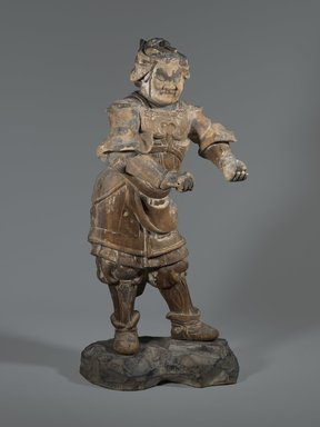 Standing Figure of Buddhist Guardian, 13th-14th century. Wood sculpture with traces of polychromy, 23 7/16 x 11 5/8 in. (59.5 x 29.5 cm). Brooklyn Museum, Carll H. de Silver Fund and Museum Collection Fund, 61.1. Creative Commons-BY