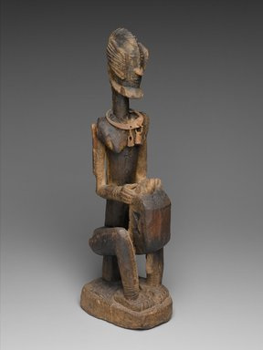 Dogon. Figure of a Seated Musician (Koro Player), late 18th century. Wood, iron, 22 x 7 x 4 1/4 in. (55.8 x 17.7 x 10.8 cm). Brooklyn Museum, Frank L. Babbott Fund, 61.2. Creative Commons-BY