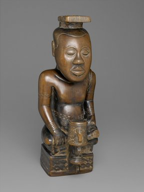 Kuba (Bushoong subgroup). Ndop Portrait of King Mishe miShyaang maMbul, ca. 1760-1780. Wood (crossopterix febrifuga), camwood powder, 19 1/2 x 7 5/8 x 8 5/8 in.  (49.5 x 19.4 x 21.9 cm). Brooklyn Museum, Purchased with funds given by Mr. and Mrs. Alastair B. Martin, Mrs. Donald M. Oenslager, Mr. and Mrs. Robert E. Blum, and the Mrs. Florence A. Blum Fund, 61.33. Creative Commons-BY
