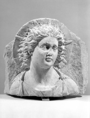 Head of Helios in High Relief Against a Pedimental Background. Limestone Brooklyn Museum, Charles Edwin Wilbour Fund, 62.148. Creative Commons-BY