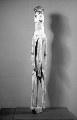 Asmat. Male Figure (Kawe), 20th century. Wood, pigment, seed, 45 x 7 x 5 1/2 in. (114.3 x 17.8 x 14 cm). Brooklyn Museum, Gift of Stanley Ross, 62.55.14. Creative Commons-BY