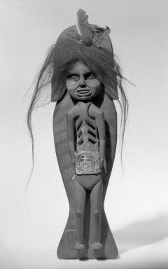 Tlingit (Native American). Shaman's Doll Riding on the Back of a Killer Whale, 1834-1867. Red cedar, pigment, leather, human hair, feathers, 16 9/16 x 4 3/4 in.  (42 x 12 cm). Brooklyn Museum, Frank L. Babbott Fund, 62.82. Creative Commons-BY