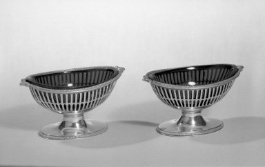 Hester Bateman (English, active in London, 1774-1789). Salts, One of Pair, ca. 1788-1789. Silver, glass, 2 1/8 x 2 3/4 x 4 in. (5.4 x 7 x 10.2 cm). Brooklyn Museum, Gift of Mr. and Mrs. Frederick B. Hicks, 64.152.15a-b. Creative Commons-BY