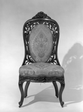 John Henry Belter (American, born Germany, 1804-1863). Side Chair (one of a pair with 64.153.2), ca. 1855. Rosewood, modern upholstery, 38 1/2 in. (97.8 cm). Brooklyn Museum, Gift of Mrs. Charles S. Jenney, 64.153.1. Creative Commons-BY
