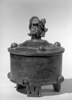 Maya. Cylindrical Tripod Vessel and Cover, C.E. 300-600. Ceramic, dark brown glossy slip, 9 5/8 x 7 3/16 x 7 3/16 in. (24.5 x 18.3 x 18.3 cm). Brooklyn Museum, A. Augustus Healy Fund, 64.163.1. Creative Commons-BY