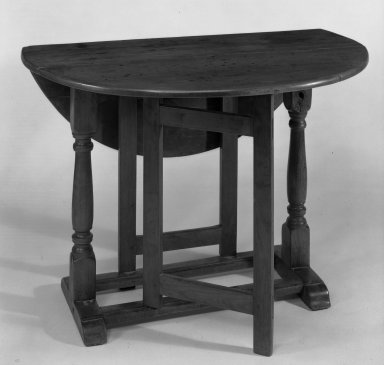 American. Drop Leaf Table with Trestle Legs and Straight Gates, ca. 1690. Cherry wood Brooklyn Museum, Gift of Jerome Blum, 64.201. Creative Commons-BY