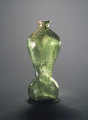 Louis Comfort Tiffany (American, 1848-1933). Vase, ca. 1900. Green glass, 10 x 3 1/4 in. (25.4 x 8.3 cm). Brooklyn Museum, Gift of Mrs. Anthony Tamburro in memory of her father, Rene de Quelin, 64.246.7. Creative Commons-BY