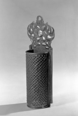 Grater, about 1675. Brass, 2 3/4 x 8 1/2 in. (7 x 21.6 cm). Brooklyn Museum, Purchased with funds given by anonymous donors, 64.3.7. Creative Commons-BY