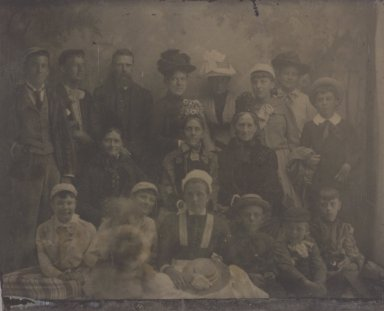 [Untitled]  (Seventeen Member Group Portrait). Tintype, 2 3/8 x 3 in.  (6.0 x 7.6 cm). Brooklyn Museum, Gift of Roland Hart, 65.230m