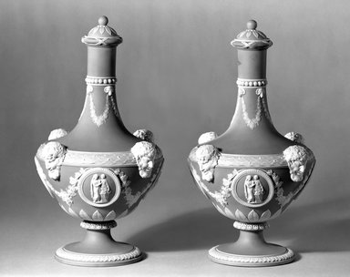 Wedgwood (1759-present). Pair of Barber Bottles with Lids, ca. 1830. Blue jasperware, 10 x 5 in. (25.4 x 12.7 cm). Brooklyn Museum, Gift of the Bess and Sam Zeigen Family, 66.229.8a-d. Creative Commons-BY