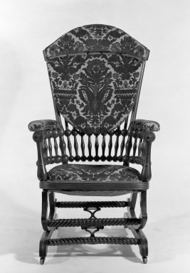 George Jacob Hunzinger (American, born Germany, 1835-1898). Platform Rocking Armchair, Patented September 26, 1882 and April 3, 1888. Wood, modern upholstery, metal, 42 11/16 x 26 x 30 in. (108.5 x 66 x 76.2 cm). Brooklyn Museum, Gift of Mrs. Darwin R. James III, 66.26. Creative Commons-BY