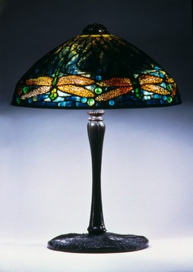 "Clara Driscoll (American, born St. Mary's, Texas, 1881-1945). ""Dragonfly"" Lamp, ca. 1900-1920. Glass, bronze, and lead, 18 1/4 x 14 x 14 in. (46.4 x 35.6 x 35.6 cm). Brooklyn Museum, Bequest of Laura L. Barnes, 67.120.54. Creative Commons-BY"