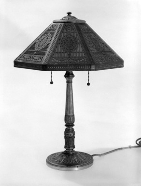 Tiffany Studios (1902-1932). Lamp, ca. 1910. Gilded brass, glass, 17 3/4 x 13 x 13 in. (45.1 x 33 x 33 cm). Brooklyn Museum, Bequest of Laura L. Barnes, 67.120.55. Creative Commons-BY