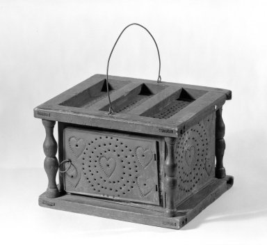 American. Footwarmer, ca. 1780. Tin and Butternut (?), 5 3/4 x 9 x 7 3/4 in. (14.6 x 22.9 x 19.7 cm). Brooklyn Museum, Gift of Mr. and Mrs. Henry Sherman, 67.128.24. Creative Commons-BY