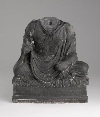 Seated Buddha, 2nd-4th century. Schist, 19 x 12 3/8 in. (48.3 x 31.4 cm) (at base). Brooklyn Museum, Gift of Arthur Wiesenberger, 67.200.3. Creative Commons-BY