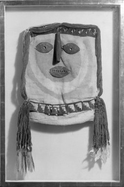Mask for Mummy Bundle. Cotton, silver?, wool, feathers, 14 3/4 in. (37.5 cm). Brooklyn Museum, Gift of Jack Lenor Larsen, 67.240.1. Creative Commons-BY