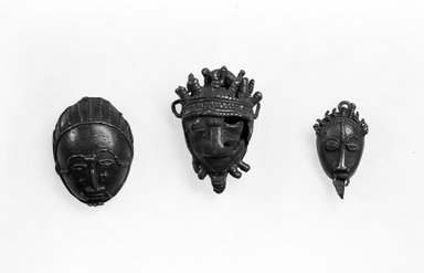 Akan. Mask-weight., 1 7/8 x 1 3/8 x 11/16 in. (4.8 x 3.5 x 1.7 cm). Brooklyn Museum, Bequest of Laura L. Barnes, 67.25.6. Creative Commons-BY