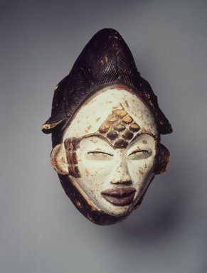 Punu. Mask for the Okuyi Society (Mukudj), late 19th century. Wood, 11 x 7 1/2 x 8 in. (27.9 x 19.1 x 20.3 cm). Brooklyn Museum, Gift of Mr. and Mrs. Milton Lowenthal through The Roebling Society, 68.160. Creative Commons-BY