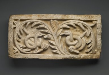 Brooklyn Museum: Recarved Plant Scroll with Snakes and Bird Heads