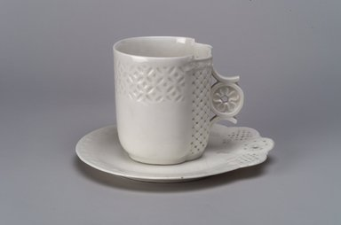 Union Porcelain Works (1863-ca. 1922). Cup and Saucer, ca. 1876. Porcelain, (a) Cup: 3 1/16 x 3 5/8 x 3 1/16 in. (7.8 x 9.2 x 7.8 cm). Brooklyn Museum, Gift of Franklin Chace, 68.87.50a-b. Creative Commons-BY