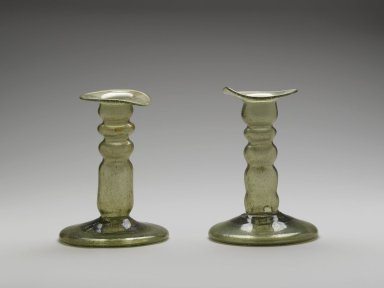 One Candlestick with Circular Base, 9th century. Glass, 5 3/8 x 3 7/8 in. (13.7 x 9.8 cm). Brooklyn Museum, Gift of Mr. and Mrs. Charles K. Wilkinson, 69.121.3. Creative Commons-BY