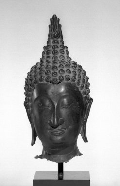Head of a Buddha, 14th-16th century. Bronze, 11 1/2 x 5 x 6 in. (29.2 x 12.7 x 15.3 cm). Brooklyn Museum, Gift of Mr. and Mrs. Paul E. Manheim, 69.125.6. Creative Commons-BY