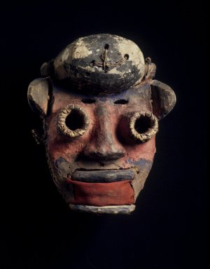 We. Mask, 20th century. Wood, cloth, vegetable, fiber, pigment, clay, 9 x 7 1/2 x 5 in. (22.9 x 19.1 x 12.7 cm). Brooklyn Museum, Gift of Merton D. Simpson to the Jennie Simpson Educational Collection of African Art, 69.133.5. Creative Commons-BY