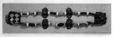 Yoruba. Beaded Necklace, late 19th century. Glass beads, felt, fiber, leather, strap: 34 3/8 x 37 in. pouches: 6 1/2 x 5 1/2 and 6 x 5 5/8 in. Brooklyn Museum, Caroline A.L. Pratt Fund, 69.134. Creative Commons-BY